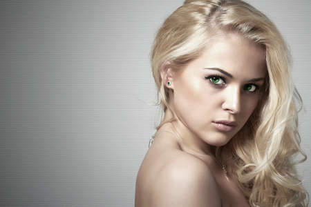 Fashion portrait of young beautiful woman.Sexy Blond girl. Gray Background Stock Photo