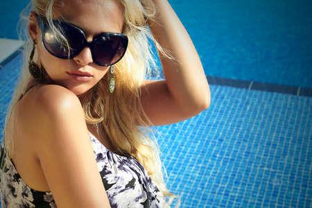 beautiful woman in sunglasses.summer girl near the swimming pool.blond woman