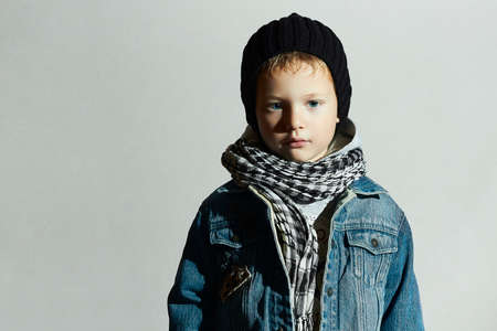 boy jeans: fashionable little boy in scarf and jeans.winter style.fashion kids.stylish child