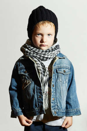fashionable little boy in scarf and jeans.winter style.fashion kids.stylish child