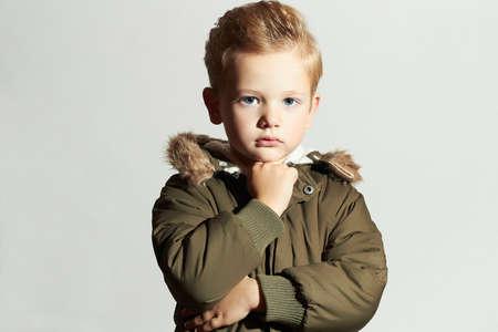 Fashionable child in winter coat. fashion kid.children.khaki parka.little boy hairstyle