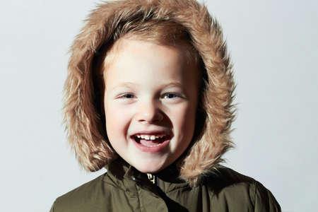 fur hood: Smiling child in fur hood. fashion kids.children.parka.little boy winter style