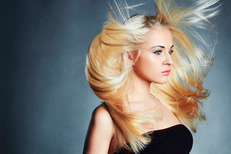 haircare: young beautiful woman with long hair. Sexy blond girl. Beauty salon haircare. Wallpaper