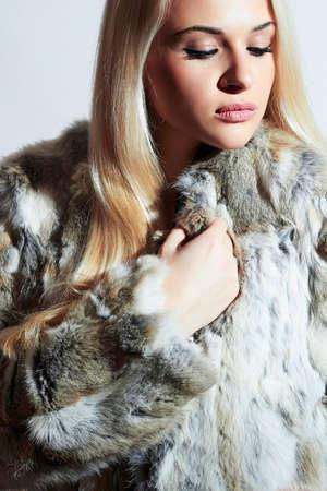 girl with black hair: Beautiful blond woman in fur.winter fashion portrait.Beauty blond Model Girl in Rabbit Fur Coat. Woman in Luxury Fur Jacket