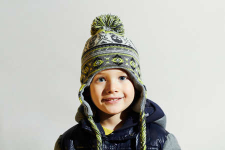 handsome boy: handsome little boy.funny smiling child.winter fashion kids.fashionable boy in winter cap