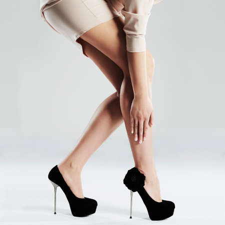 heel: long sexy woman legs.Perfect female legs in high heels.Manicure.Black shoes Stock Photo