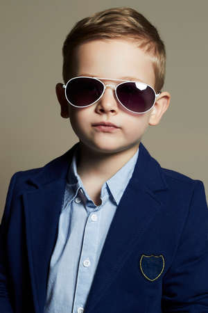 cute young boy: fashionable little boy in sunglasses.stylish kid in suit. fashion children.business boy