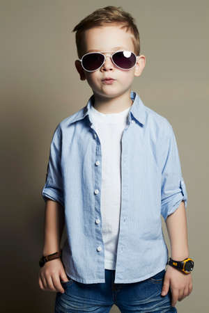 cute young boy: Funny child.fashionable little boy in sunglasses.fashion children