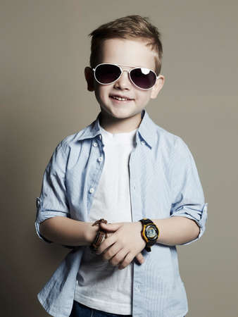 a boy: Funny child.fashionable little boy in sunglasses.fashion children