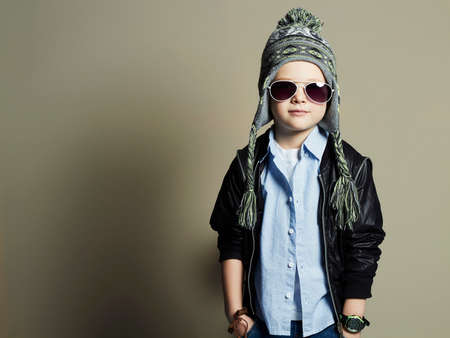 funny little boy in sunglasses.stylish kid in hat. spring fashion children