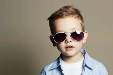 cute young boy: fashionable little boy in sunglasses.fashion children Stock Photo