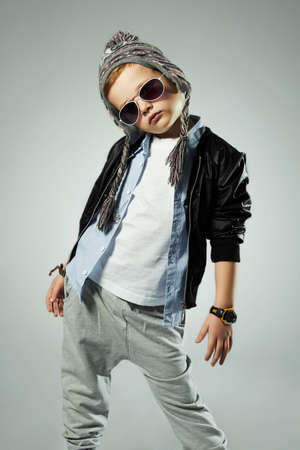 funny little boy in sunglasses.stylish kids. spring fashion children Banque d'images