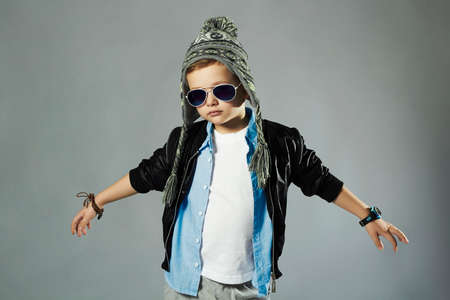 cute young boy: funny little boy in sunglasses.stylish kids. spring fashion children Stock Photo