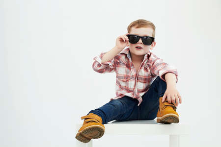 model: Funny child.fashionable little boy in sunglasses.fashion children