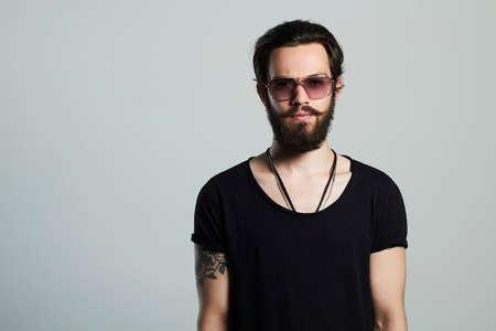 handsome man. Brutal bearded boy in trendy sunglasses