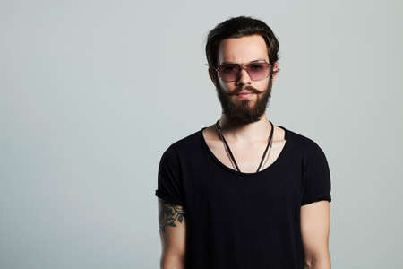 handsome man. Brutal bearded boy in trendy sunglasses