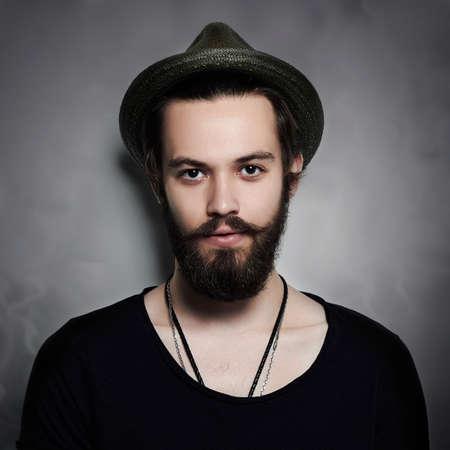 handsome bearded man in hat.Brutal boy