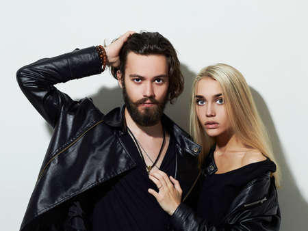 Hipster boy and girl. Bearded young man and blonde model 版權商用圖片