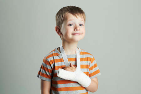 young doctors: little boy in a cast.child with a broken arm