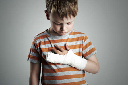 little boy in a cast.child with a broken arm.after accident Stok Fotoğraf - 53591679