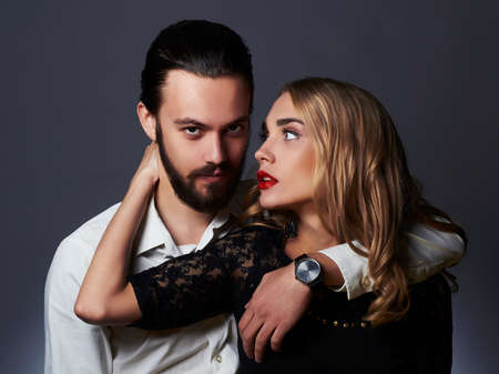 tender passion: luxury fashionable couple in tender passion. Beautiful woman near the man.beauty girl and boy together Stock Photo