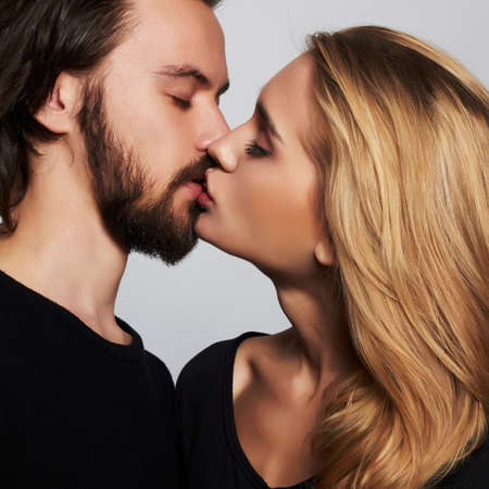Kissing couple portrait.romantic beautiful young woman and handsome man.lovely boy and girl