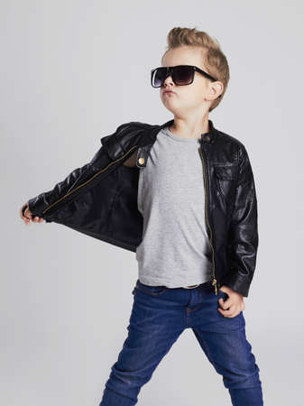 fashion boy: Fashionable child in leather coat.little boy in sunglasses. Autumn fashion Stock Photo