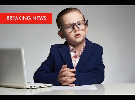 newsreader: news anchor little boy. funny child headline tv. kids news