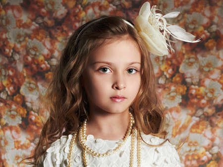 fashion portrait of beautiful little girl. floral background.funny child Stock Photo