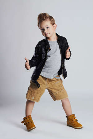 Fashionable child in leather coat.little boy hairstyle. Autumn fashion.funny smiling kid Stock Photo - 64945522