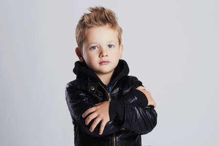 Fashionable child in leather coat.stylish little boy. Autumn fashion.funny 6 years old kid Stock Photo