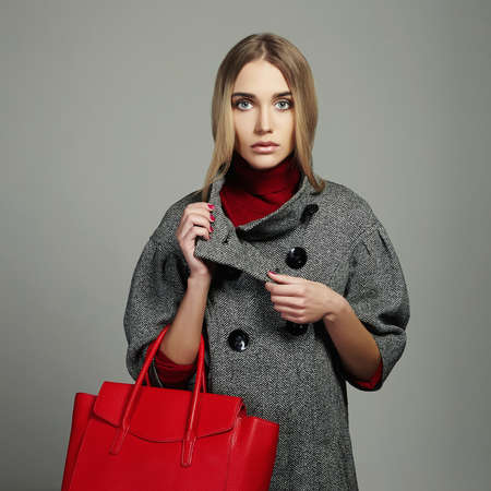 Winter beautiful Woman with Handbag.Beauty Fashion Girl in topcoat.Shopping