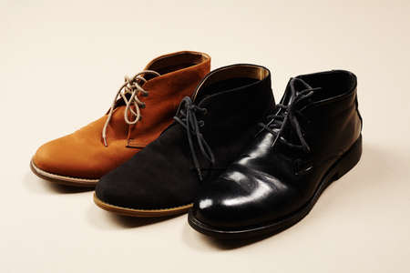 walking paths: a lot of mens shoes.fashion still life men boots Stock Photo