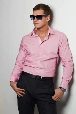 sexy gay: sexy boy in pink t-shirt and trendy glasses.handsome man in sunglasses