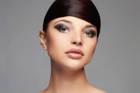 coloring lips: Fashion Beauty Portrait.Beautiful Girl Face.Hairstyle.Makeup.Woman in hair hat