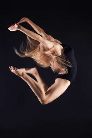 jumping beautiful gymnast girl.beauty young ballet woman.ballerina Imagens