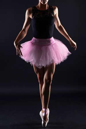 Beautiful female ballet dancer.Ballerina is wearing a leotard; tutu; pointe shoes Stock Photo