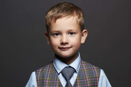 fashionable little boy.smiling funny child in suit and tie. fashion children Stock Photo
