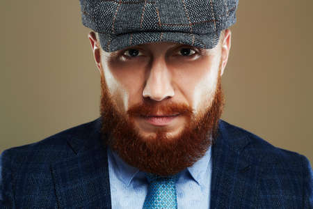 bearded man in hat.Hipster boy.handsome Brutal man with red beard Stock fotó