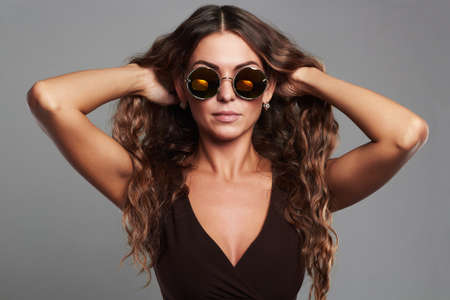 beautiful young woman in sunglasses.fashion beauty stylish girl with healthy long hair Stock Photo