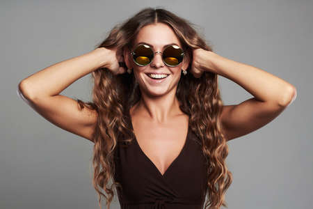 happy smiling beautiful young woman in sunglasses