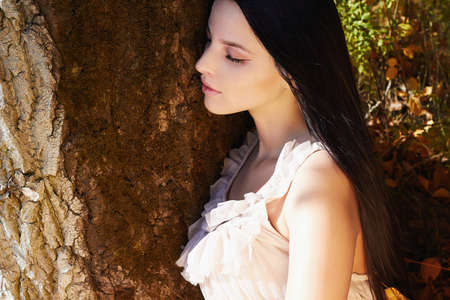 lifestyle Outdoor fashion photo of young beautiful woman walking in autumn forest Stock Photo