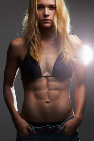 thinness: sexy beautiful thin girl in jeans shorts.muscular woman.healthy diet lifestyle Stock Photo