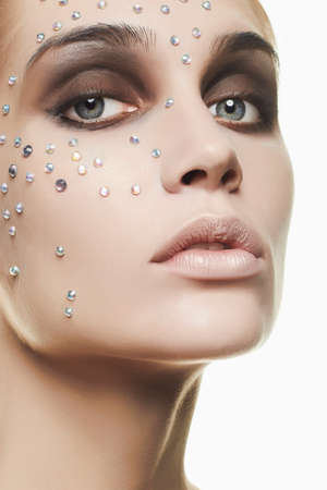 Beautiful woman with crystals on face.beauty girl Stock Photo