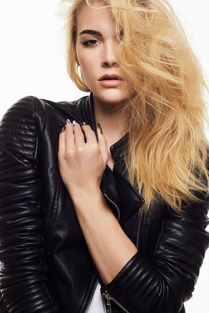 beautiful blonde girl. punk rock young woman in leather coat