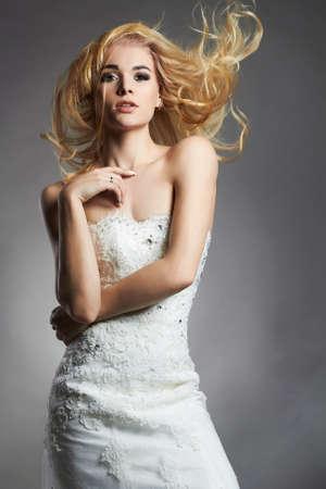beautiful blonde bride woman in wedding dress.fashion style Bride girl with flying hair Stok Fotoğraf