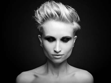 Beautiful blond woman with short hair.beauty girl make up with dark eyeshadow