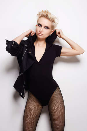 sexy beautiful blond woman with short hair. fashion beauty punk girl with smokey eyes make-up