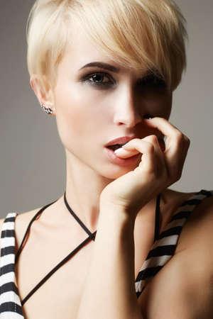 beautiful woman with fashion short haircut.blonde hair girl