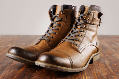 shoes. fashion mens boots.brown shoes still life on wooden table. man stuff Stock Photo